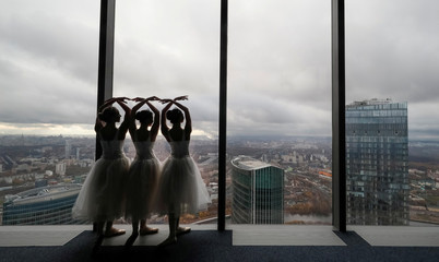 Ballerinas perform during an ice-cream factory promotional event at an observation floor of the Moscow International Business Centre in Moscow