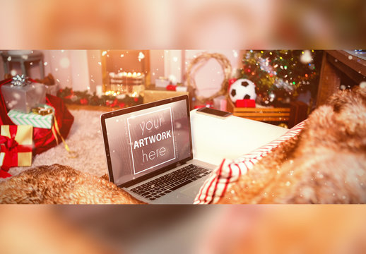 Laptop with Holiday Decorations Mockup