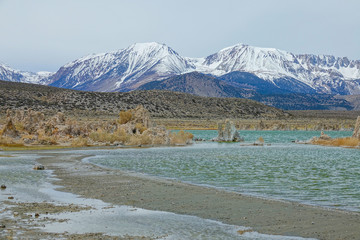 Spectacular shot of the snowy mountains behind the rocky towers in Mono Lake.