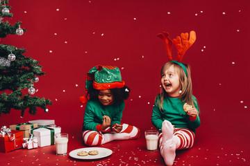 Kids having fun eating christmas cookies
