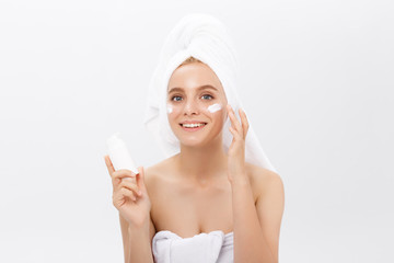 Beauty Youth Skin Care Concept - Beautiful Caucasian Woman Face Portrait holding and presenting cream tube product. Beautiful Spa model Girl with Perfect Fresh Clean Skin over white background