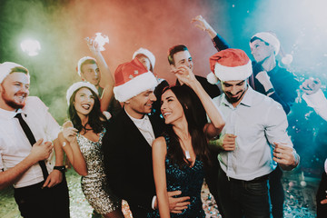 People in Santa Claus Cap Celebrating New Year.