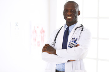 Happy afro man doctor portrait with arms crossed