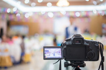 Reporter on Video camera, camcorder interviews, operator working for record speaker or Presenter in convention h, blak screen. Interview is conversation where questions are asked
