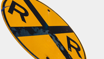 Abstract dirty dingy railroad crossing sign close up
