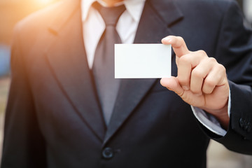 businessman giving blank name card