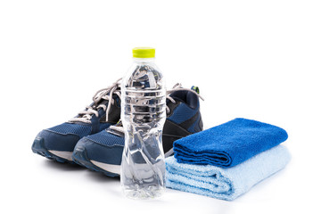 Fitness equipment ,water bottle,sport shoe,blue towel isolated on white background.