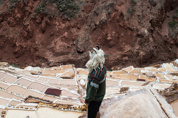 Maras salt evaporation ponds, and the surrounding scenery in sacred valley, Perù.