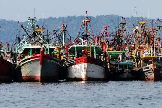A fleet of fishing boats moored at port in Asia