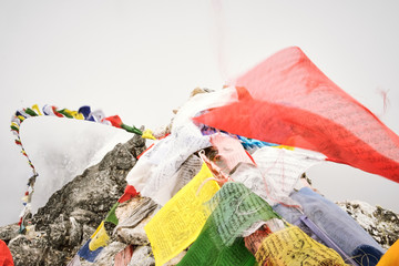 Prayer flags on a summit in the Himalayas