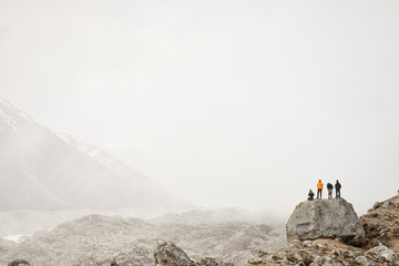A group of climbers look out over the Khumbu Glacier in the Himalayas