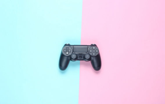 Gamepads on a colored paper background. Top view. Minimalism.