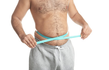 Overweight man with measuring tape on white background, closeup