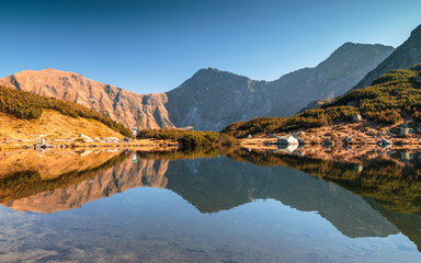 Mountain landscape with tarn at autumn, The area of Rohace in Tatras National Park, Slovakia, Europe.