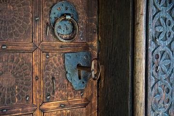 Big key in rustic door of wooden church