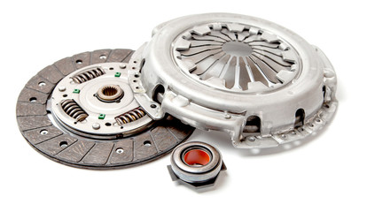 Set of replacement automotive clutch isolated on white background. Disc and clutch basket with release bearing.