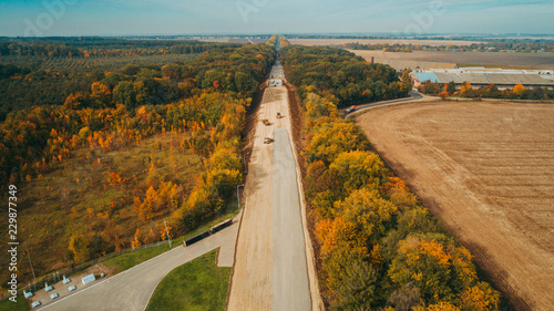 Aerial view of the road construction process  Autumn