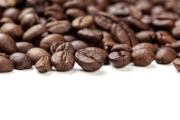 Pile coffee beans isolated on white background