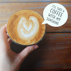 Inspirational motivation quote about coffee on cup of hot latte with hand