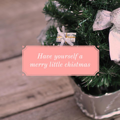 Inspirational motivation quote about holiday on christmas tree background