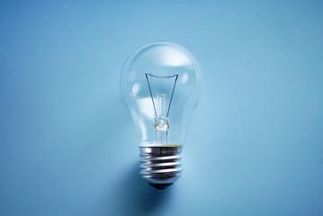 Traditional lightbulb on blue