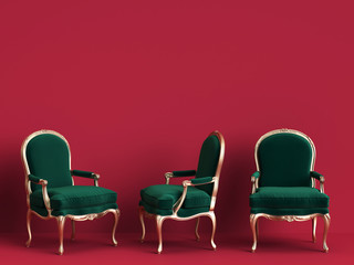 Classic chairs in emerald green and gold on red background with copy space