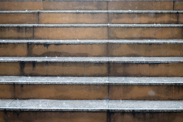 Close up of a staircase steps Rain drops in the water heavy wet During the rainy season, rustic look. Concrete going up looking railing. Architectural stairway in the city. landmarks wide stone stairs