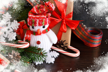 New Year background with gifts, sweets and a snowman. Happy New Year and Merry Christmas.