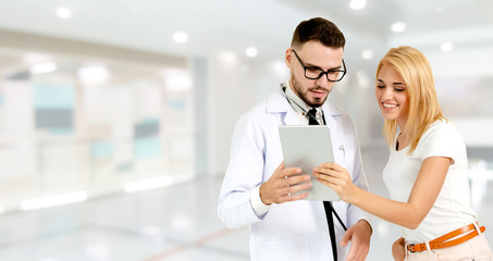 Doctor talking to patient in the hospital.