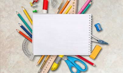 Colorful school supplies on white background