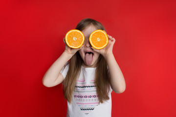 happy little girl with oranges, concept of childhood Wall mural