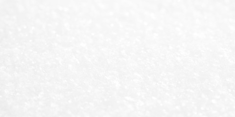 Shiny white background. A snow texture on a winter sunny day.