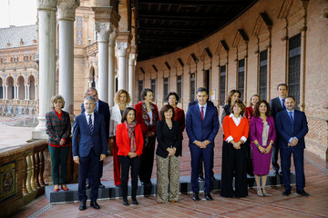 Spain's Prime Minister Pedro Sanchez and cabinet ministers pose for a family photo ahead of a cabinet meeting in Seville