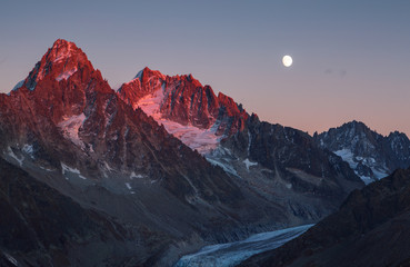 Fotomurales - The last sunlight on mountain peak Aiguille D'Argentiere during moonrise. Chamonix, France.