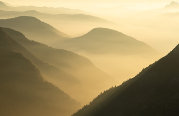 Fotomurales - A foggy, autumn sunset in a mountain wilderness. Mont Blanc Massif, France.