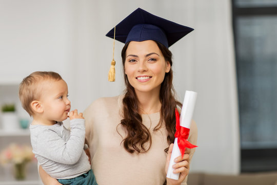 education, graduation and motherhood concept - happy mother student with baby boy and diploma at home