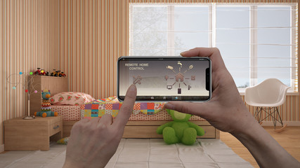Remote home control system on a digital smart phone tablet. Device with app icons. Interior of modern colored child bedroom in the background, architecture design