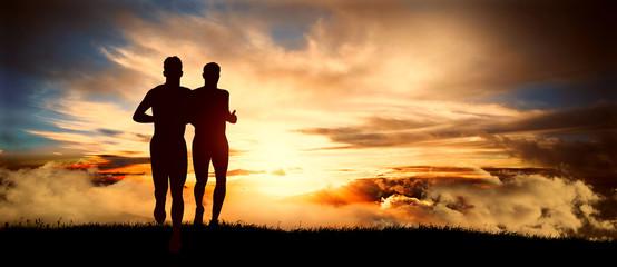 two men run at sunset
