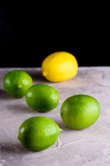 Juicy and fragrant lemons. Green and yellow lemons on a concrete background. Lemons on a blue background.