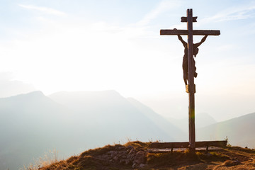 Wooden crucifix with Jesus on a mountain hill