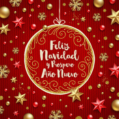 Feliz navidad - Christmas greetings in Spanish. Holiday greeting in a ornate frame and Christmas decoration on a knitted red background.