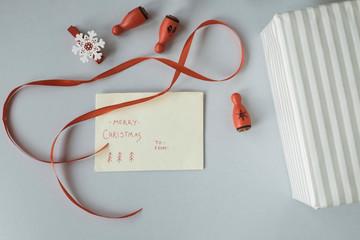 Writing Christmas cards and wrapping Christmas presents