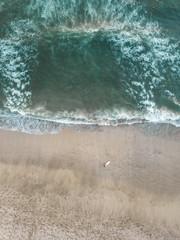 Indonesia, Bali, Aerial view of Padma beach, surfer