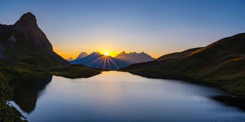 Germany, Bavaria, Allgaeu, Allgaeu Alps, Lake Rappensee, Kleiner Rappenkopf at sunset