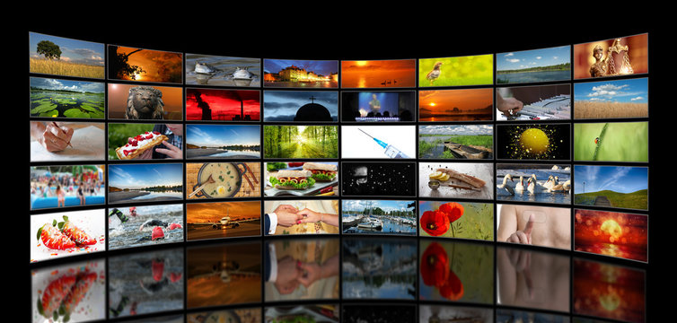 Wall of stacked TV screens with various motifs on a black background