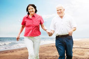 Senior Couple Walking At Beach