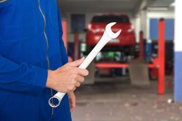 Car Mechanic Holding Spanner