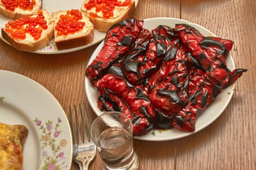 Grilled sweet red pepper on a plate on a festive wooden table