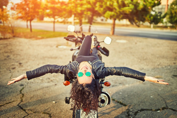 Young woman resting sitting on a motorcycle . Travel and tourism concept Fototapete
