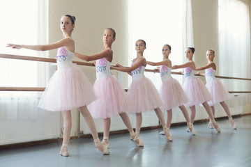 Group of young ballerinas training choreography, copy space